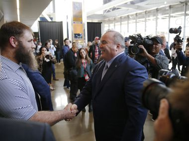 Dallas Cowboys center Travis Frederick (72) meets Dallas Cowboys new head coach Mike McCarthy after his introductory press conference in the Ford Center at The Star in Frisco, on Wednesday, January 8, 2020.