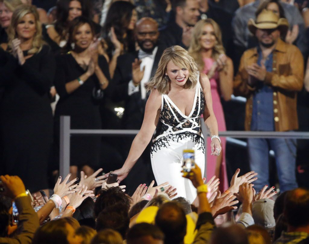 Miranda Lambert high-fives fans as she receives her Album of the Year award during the 2015 Academy of Country Music Awards Sunday, April 19, 2015 at AT&T Stadium in Arlington, Texas.