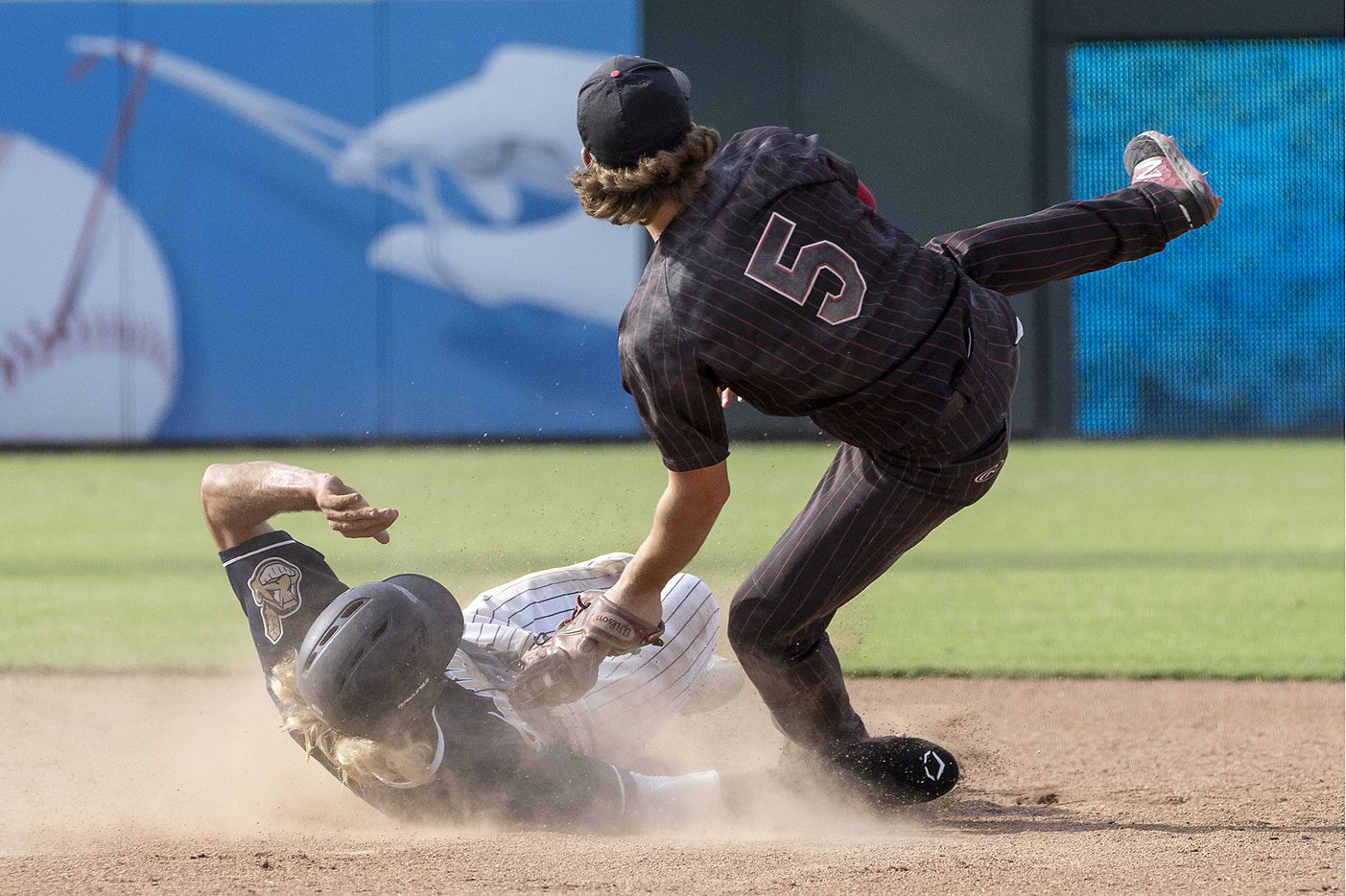 Rockwall-Heath Karson Krowka, (5), tags out Keller Gray Rowlett, (21), as they collide at second base during the fifth inning of the 2021 UIL 6A state baseball final held, Saturday, June 12, 2021, in Round Rock, Texas.  Rockwall-Heath defeated Keller 4-3.   (Rodolfo Gonzalez/Special Contributor)