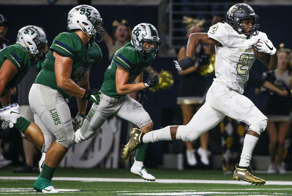 The Colony's Myles Price (2) runs for a touchdown past Frisco Reedy defensive tackle Brock Miller (95) in the first half of their non district football game on Thursday, Sept. 6, 2018 at The Ford Center at The Star in Frisco, Texas. (Shaban Athuman/ The Dallas Morning News)  ORG XMIT: 20041646A