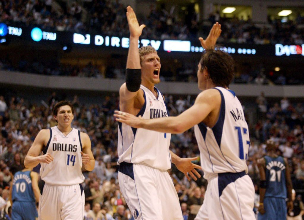 Dallas Mavericks Dirk Nowitzki (41) celebrates with Steve Nash (13) after Nowitzki rejected a shot by Minnesota Timberwolves Kevin Garnett during the third period at American Airlines Center in Dallas, TX, on Wednesday, April 24, 2002.  Also shown is Eduardo Najera (14 ).