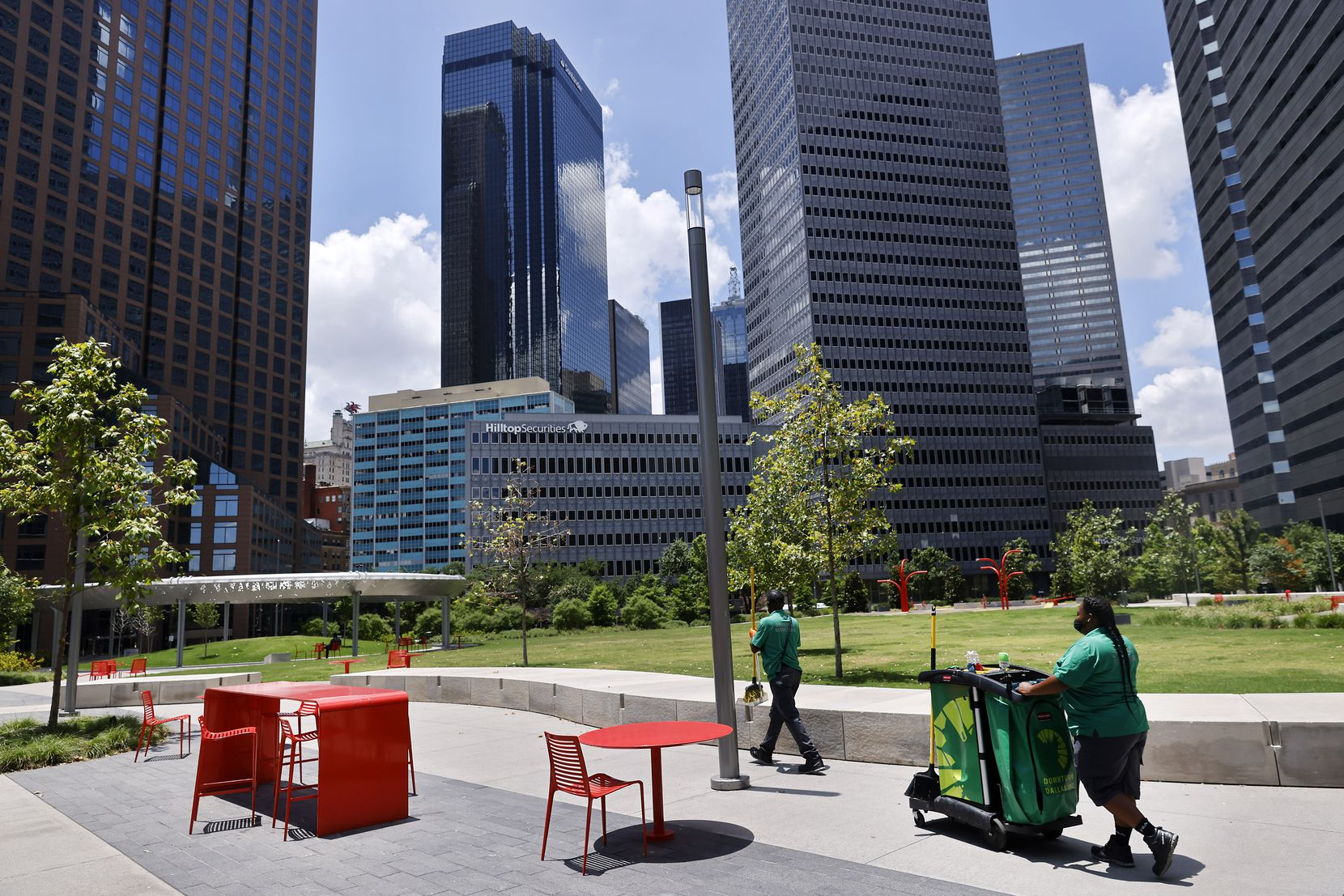 Downtown Dallas Inc. clean-team members work Wednesday in Pacific Plaza.