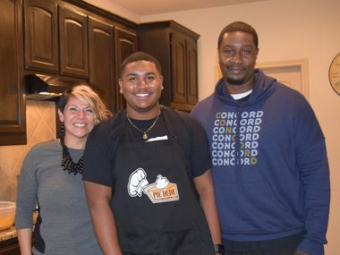 """DeSoto's """"The Pie Dude"""" (center, Kevin Robinson Jr.) with his mother Jackie and father Kevin Robinson Sr."""