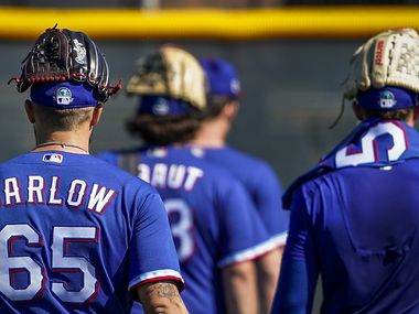 Texas Rangers pitcher Joe Barlow and teammates head for the clubhouse after a spring training workout at the team's training facility on Saturday, Feb. 15, 2020, in Surprise, Ariz.