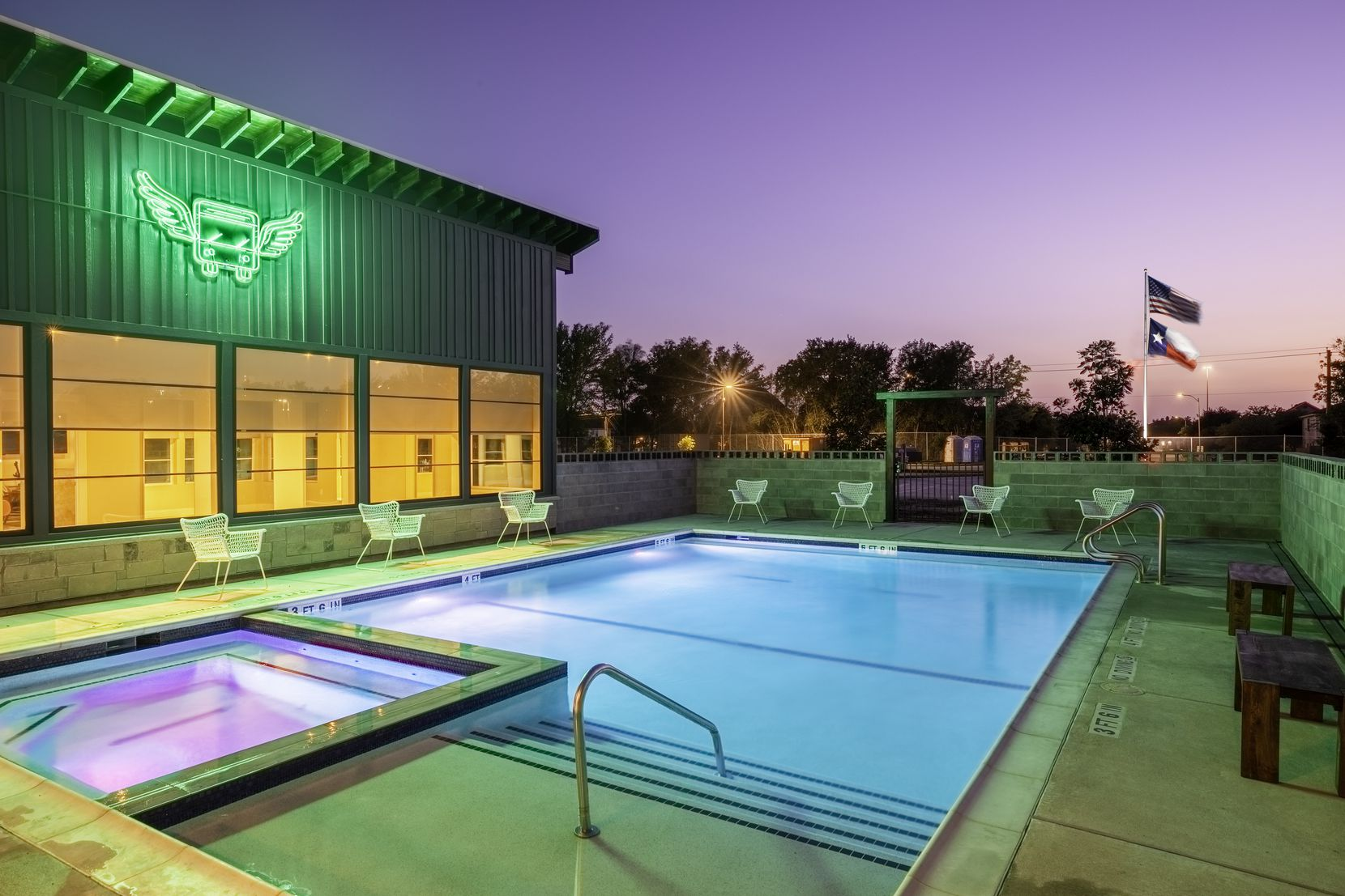 Eric & Jay's RV Resort in Houston features a pool with a Jacuzzi and a modern farmhouse-style clubhouse with a game room, coffee bar, fitness center and other amenities.