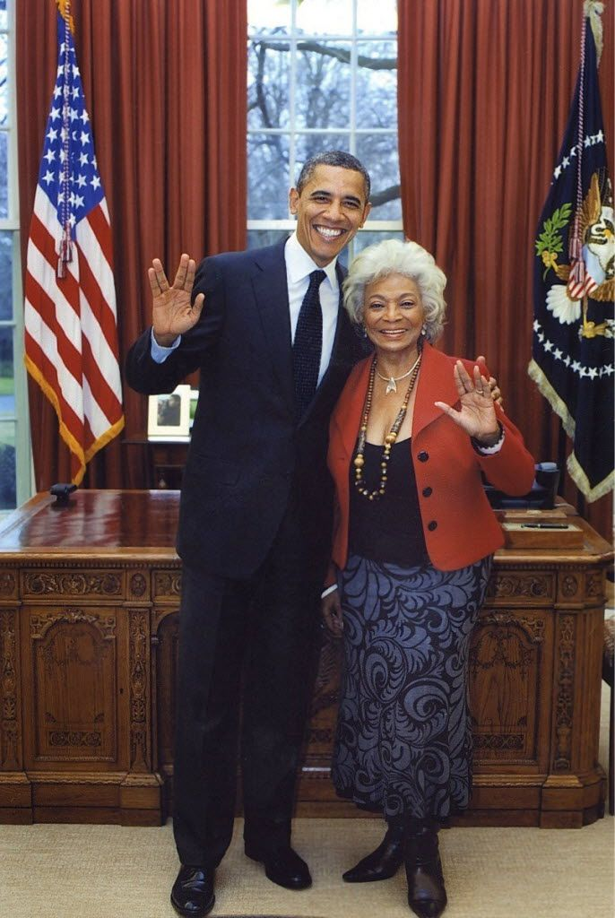 President Barack Obama and Star Trek actress give the Vulcan salute in the Oval Office at the White House.