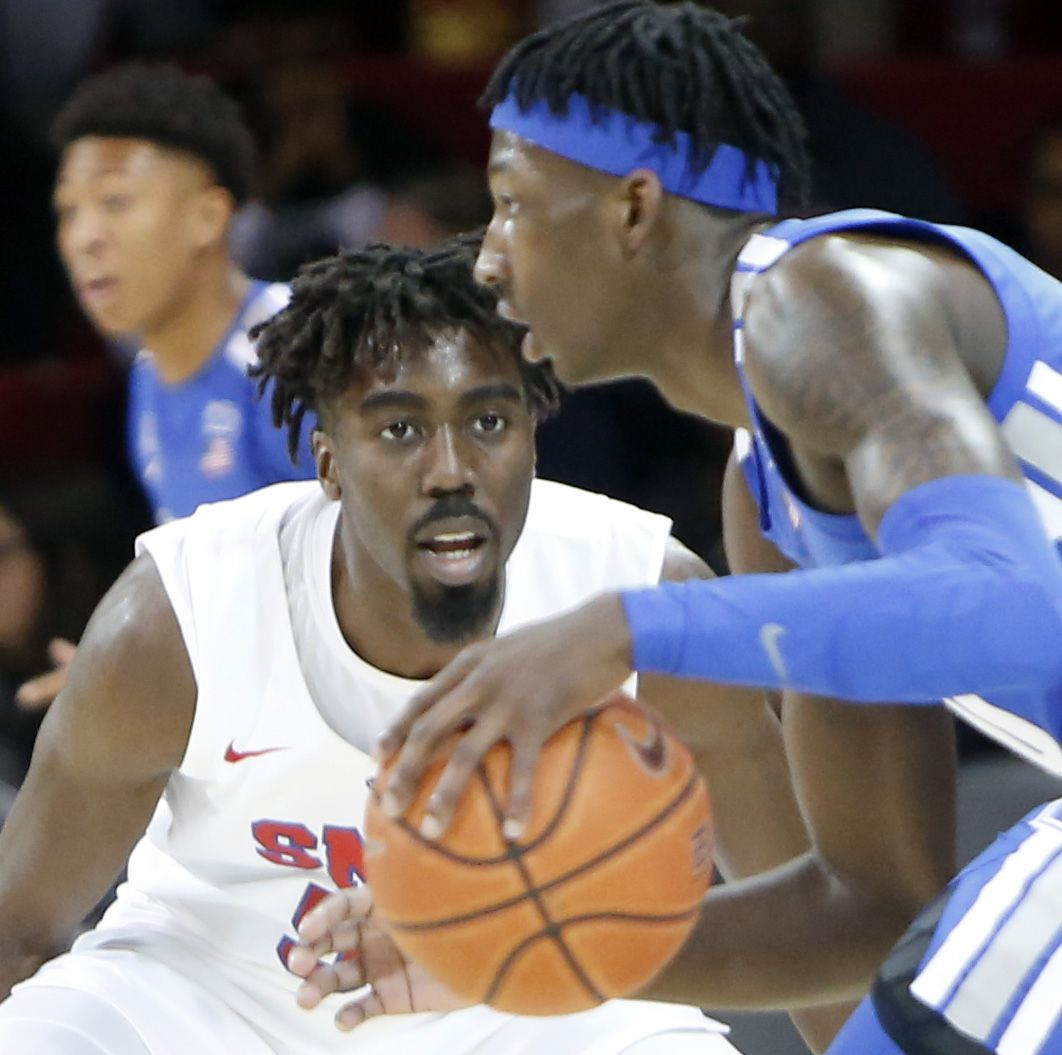 SMU guard Emmanuel Bandoumez (5) applies aggressive defense as Memphis guard Damion Blaugh (10)looks to pass during first half action. The two teams from the NCAA's American Athletic Conference played their men's basketball game at SMU's Moody Coliseum in Dallas on February 25, 2020.