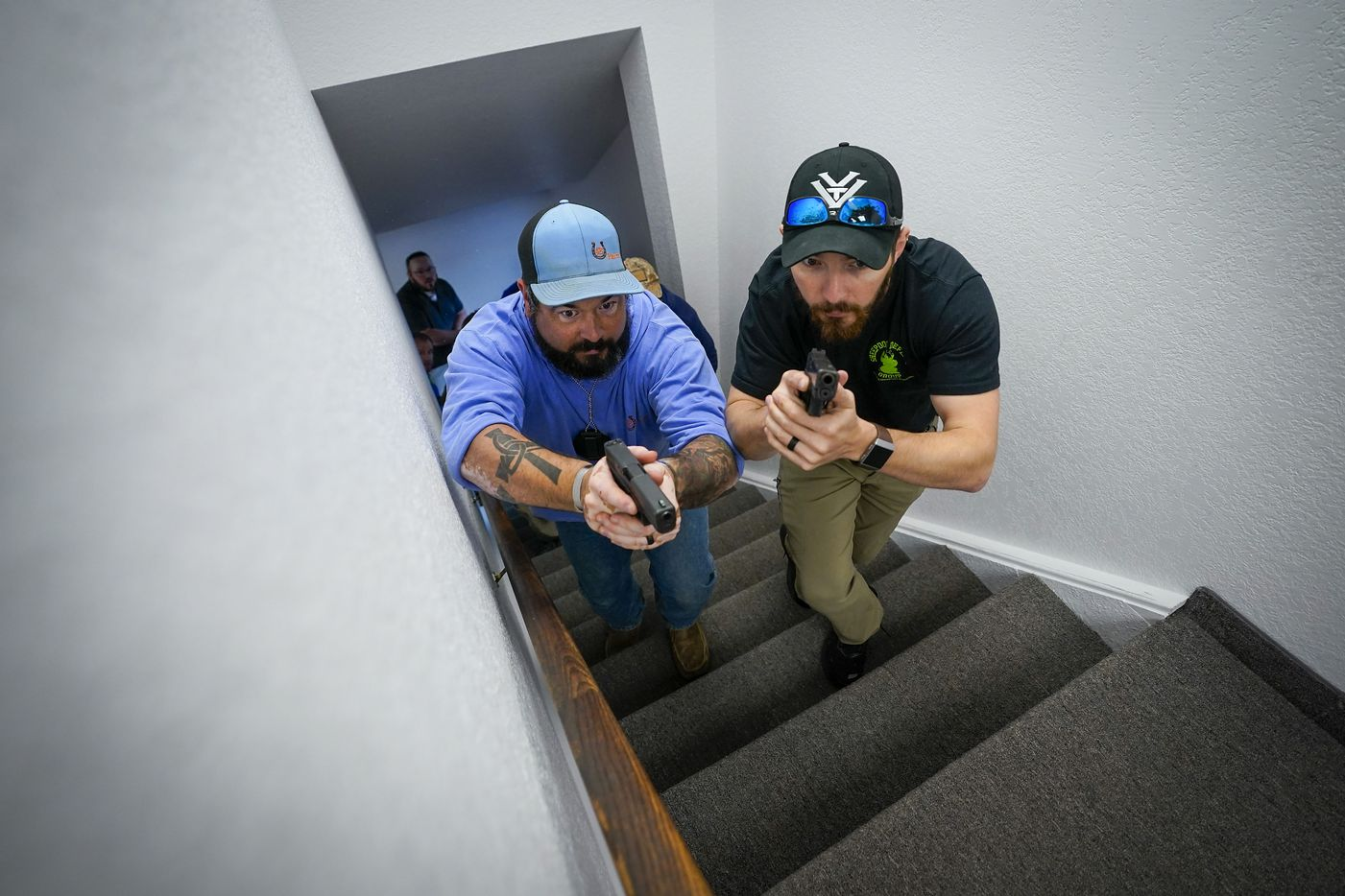 Tyler Brooks (left), from Cornerstone Community Church in Springtown, TX and Dave Harding, from Eagles View Church in Fort Worth, search for a shooter in a simulation during a Sheepdog Defense Group armed security programs church safety training session at Cornerstone Community Church on Sunday, Feb. 2, 2020 in Springtown, Texas.