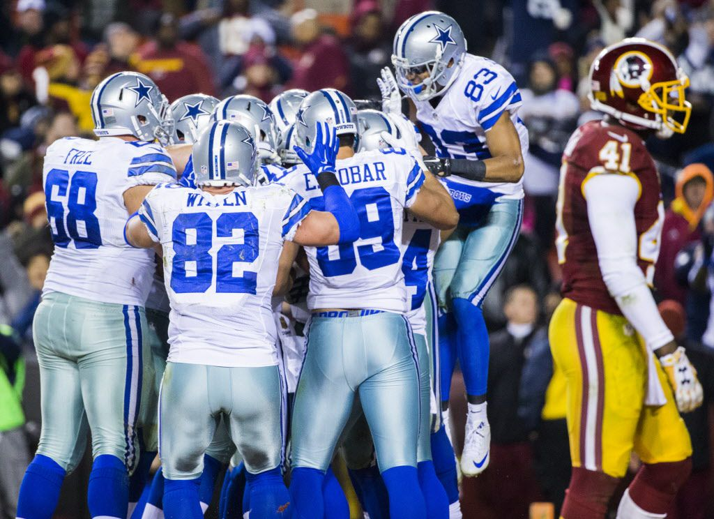 The Dallas Cowboys celebrate after scoring a touchdown during the fourth quarter of their game against the Washington Redskins on Monday, December 7, 2015 at FedEx Field in Landover, Maryland.  The Cowboys won 19-16. (Ashley Landis/The Dallas Morning News)