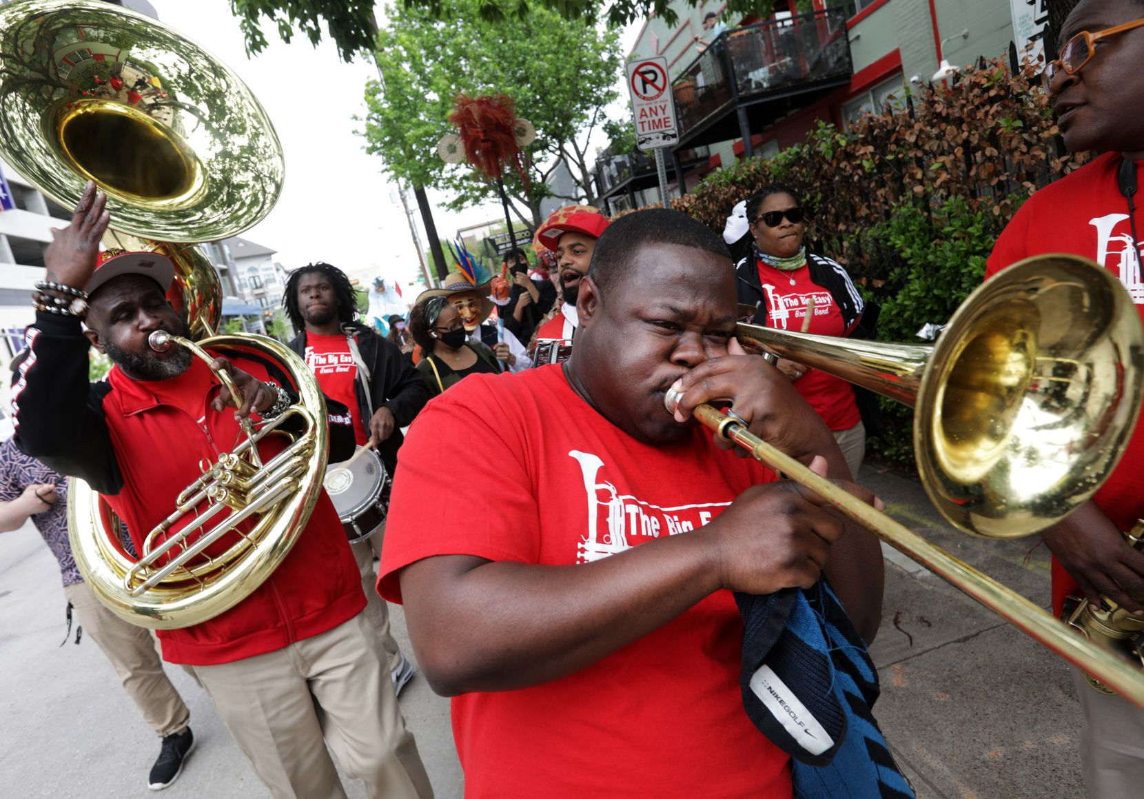 """The Big Easy Brass Band leads a procession down Live Oak Street in Old East Dallas during """"¡Soltar!"""" The spring renewal celebration was held April 17, with a reprise scheduled for the 24h."""