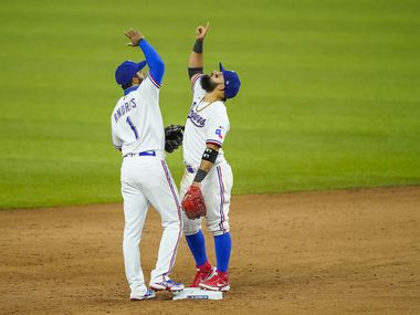 Texas Rangers shortstop Elvis Andrus and second baseman Rougned Odor celebrate after a 1-0 victory on opening day against the Colorado Rockies at Globe Life Field on Friday, July 24, 2020. (Smiley N. Pool/The Dallas Morning News)