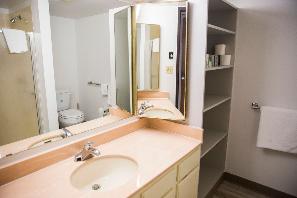 The bathroom of a room inside St. Jude Center, a senior-living facility for homeless in northwest Dallas