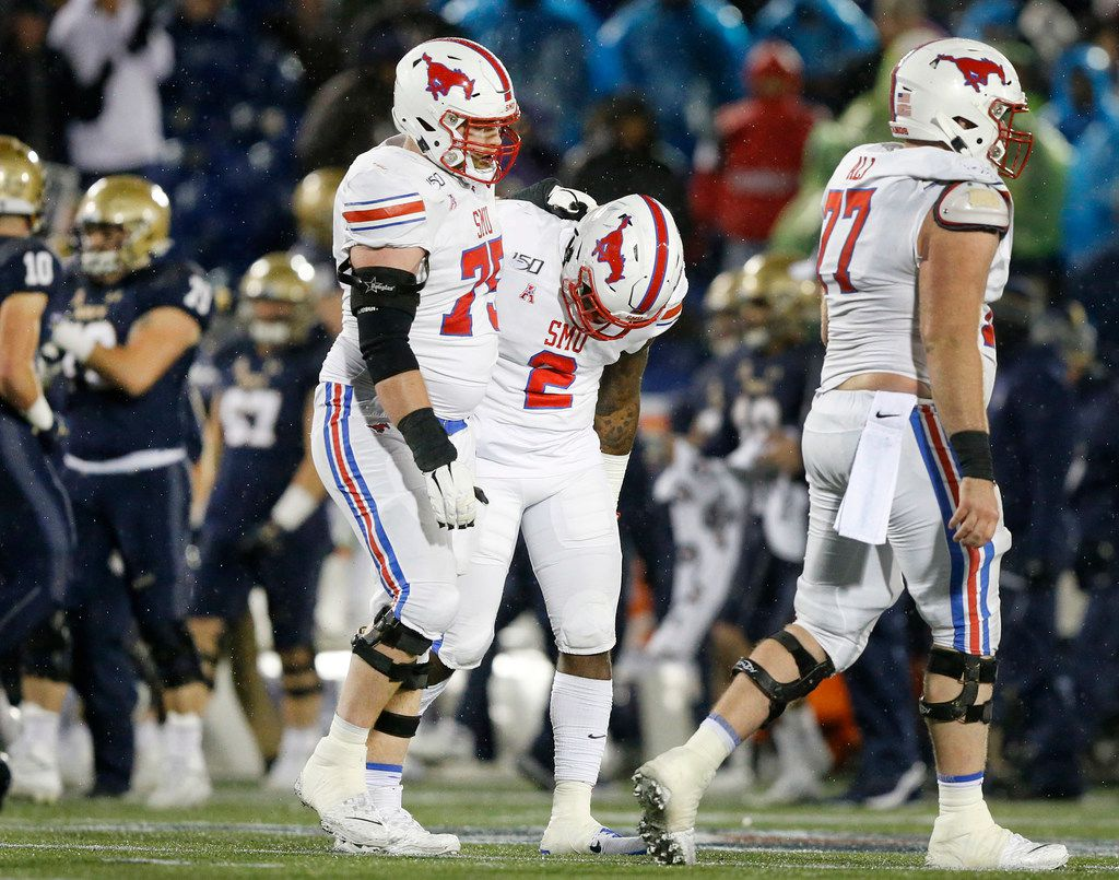 Southern Methodist Mustangs offensive lineman Hayden Howerton (75) consoles running back Ke'Mon Freeman (2) after they failed to convert on fourth down late in the fourth quarter against the Navy Midshipmen at Navy-Marine Corps Memorial Stadium in Annapolis, Maryland, Saturday, November 23, 2019. The Mustangs lost, 35-28.(Tom Fox/The Dallas Morning News)