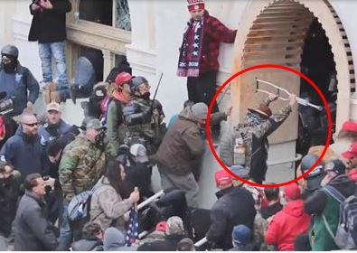 Luke Coffee is shown confronting police who were trying to defend the U.S. Capitol from rioters on Jan. 6.