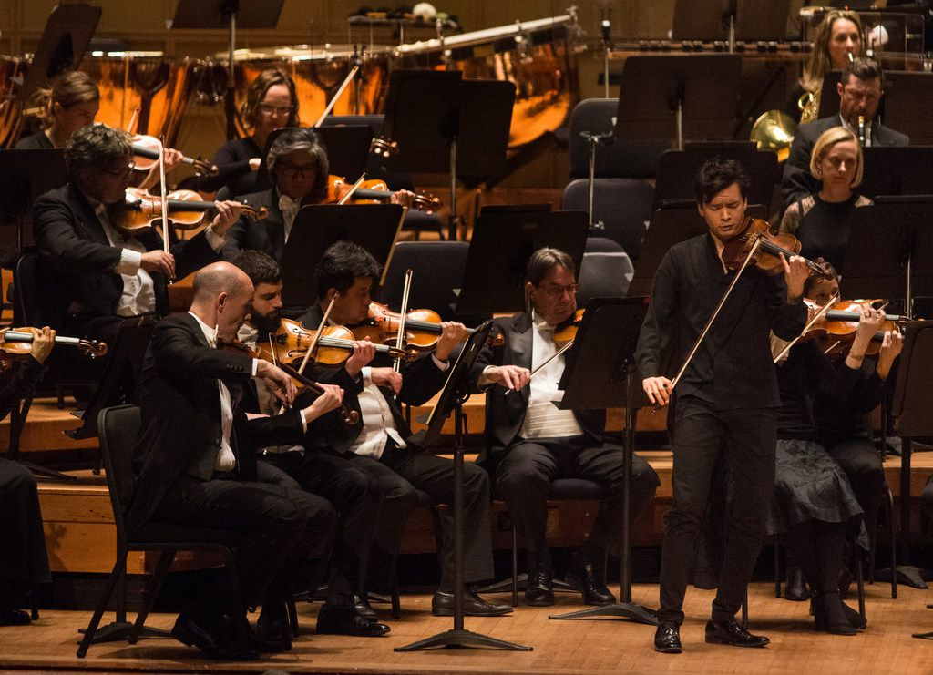 Led by guest conductor Juraj Valcuha, violin soloist Stefan Jackiw performs with the Dallas Symphony Orchestra at the Meyerson Symphony Center on Thursday.