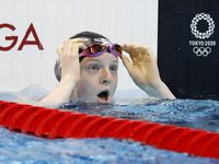 USA's Lydia Jacoby reacts after noticing she won in the women's 100 meter breaststroke final during the postponed 2020 Tokyo Olympics at the Tokyo Aquatics Center on Monday, July 26, 2021, in Tokyo, Japan. Jacoby won with a time of 1:04.95 to take gold.