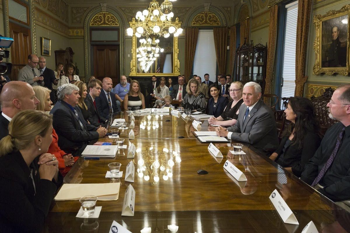 Robert and Amy Dean, of Fort Worth, seated at the head of the center-left head of the table, were among several families to meet with Vice President Mike Pence at the White House on June 26, 2017, to discuss health care.