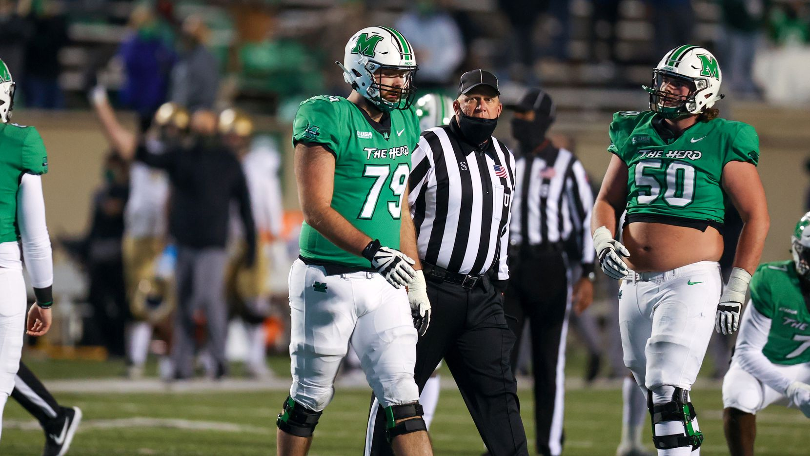 Marshall Thundering Herd offensive lineman Josh Ball (79) is escorted to the sideline by an official after being ejected during the fourth quarter of the 2020 Ryan C-USA Football Championship Game between the UAB Blazers and the Marshall Thundering Herd on October 24, 2020, at Joan C. Edwards Stadium in Huntington, WV.