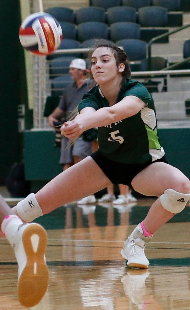 Prosper's Nikki Steinheiser (15) returns the ball during the first game of their match against Plano West.  The two teams played their District 9-6A volleyball match at Prosper High School in Prosper on October 22, 2019. (Steve Hamm/ Special Contributor)