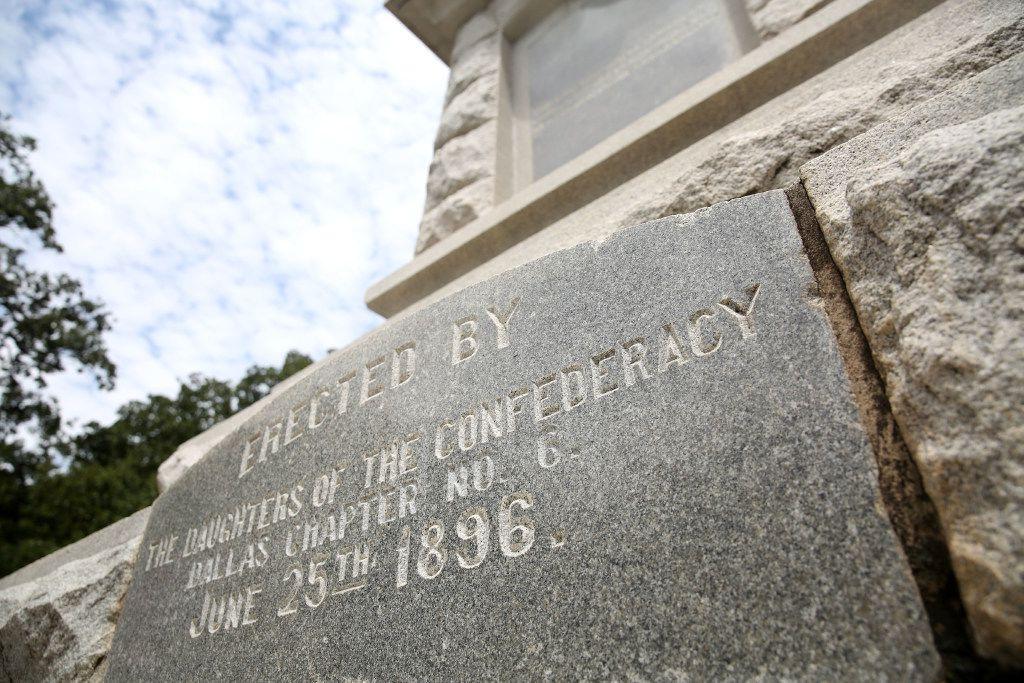 """An inscription on the Confederate War Memorial in Dallas on Tuesday, Aug. 15, 2017. It reads, """"Erected by The Daughters of the Confederacy, Dallas Chapter No. 6, June 25th, 1896."""" The monument originally stood at what is Old City Park, but was moved in the 1960s for road construction of the R.L. Thornton freeway portion of Interstate 30. (Rose Baca/The Dallas Morning News)"""