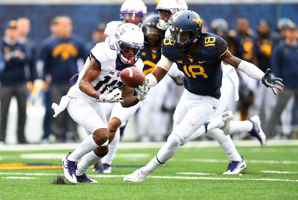 MORGANTOWN, WV - OCTOBER 22:  Desmon White #10 of the TCU Horned Frogs bobbles a kickoff in front of Marvin Gross #18 of the West Virginia Mountaineers during the second quarter at Mountaineer Field on October 22, 2016 in Morgantown, West Virginia. (Photo by Joe Sargent/Getty Images)