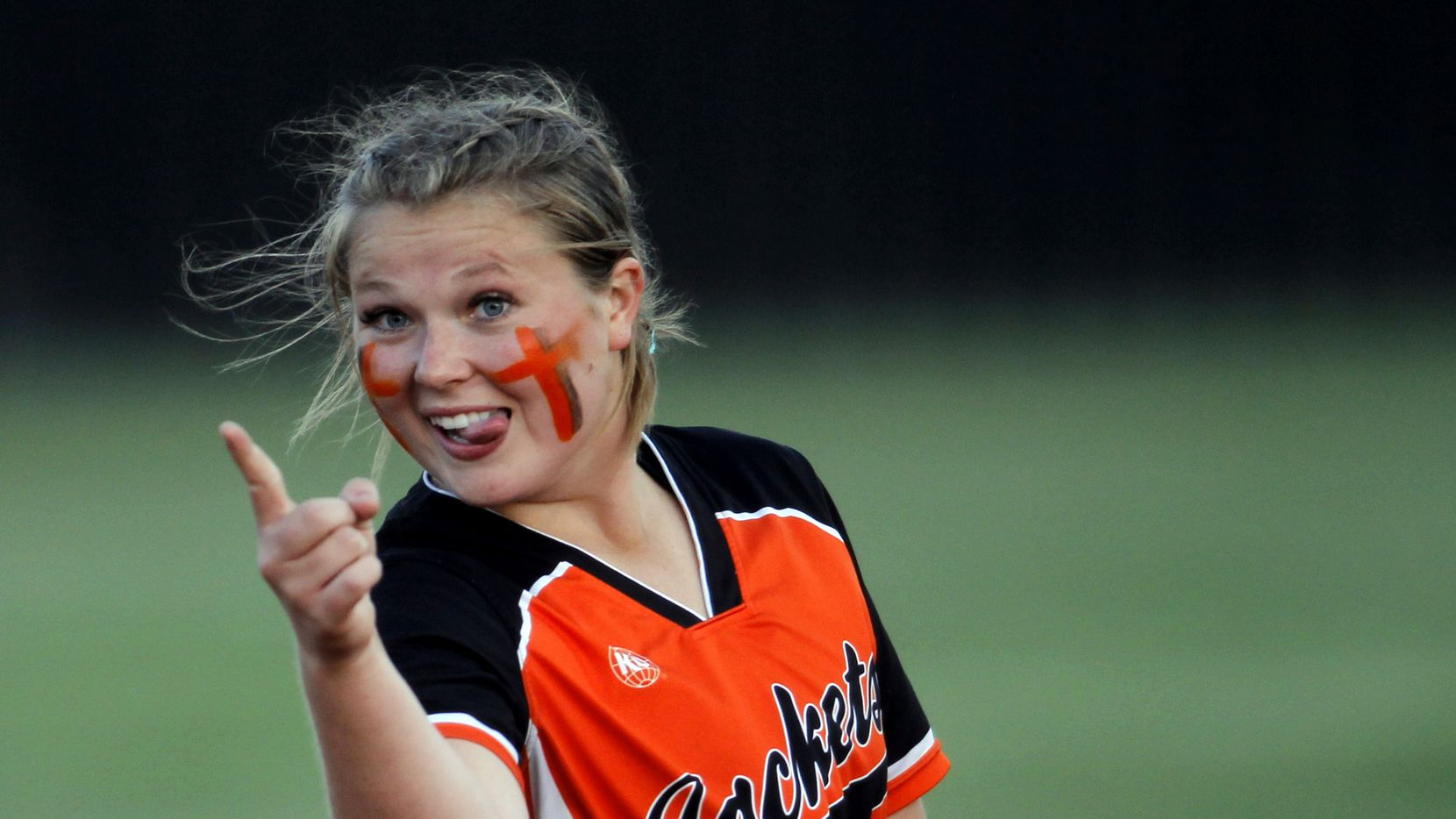 Rockwall first baseman  Elizabeth Schaefer (21) gestures to a teammate after making a put-out during the bottom of the 2nd inning of play against Mansfield. The two teams played their Game 2 of a best-of-3 Class 6A area round playoff softball game at Mansfield High School in Mansfield on May 7 2021.