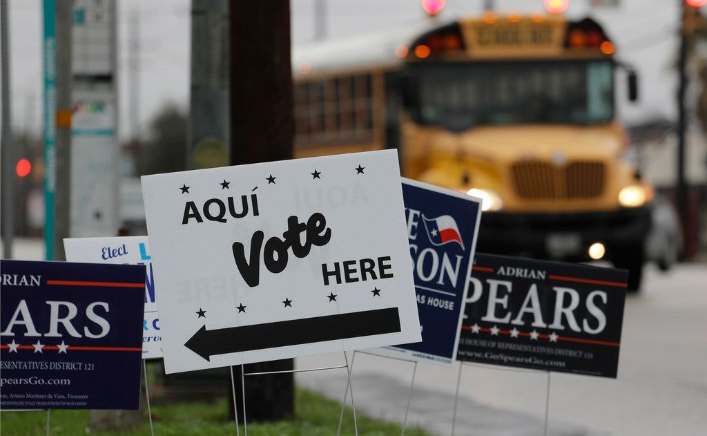 In this March 2, 2018, file photo, signs mark a polling site in San Antonio.