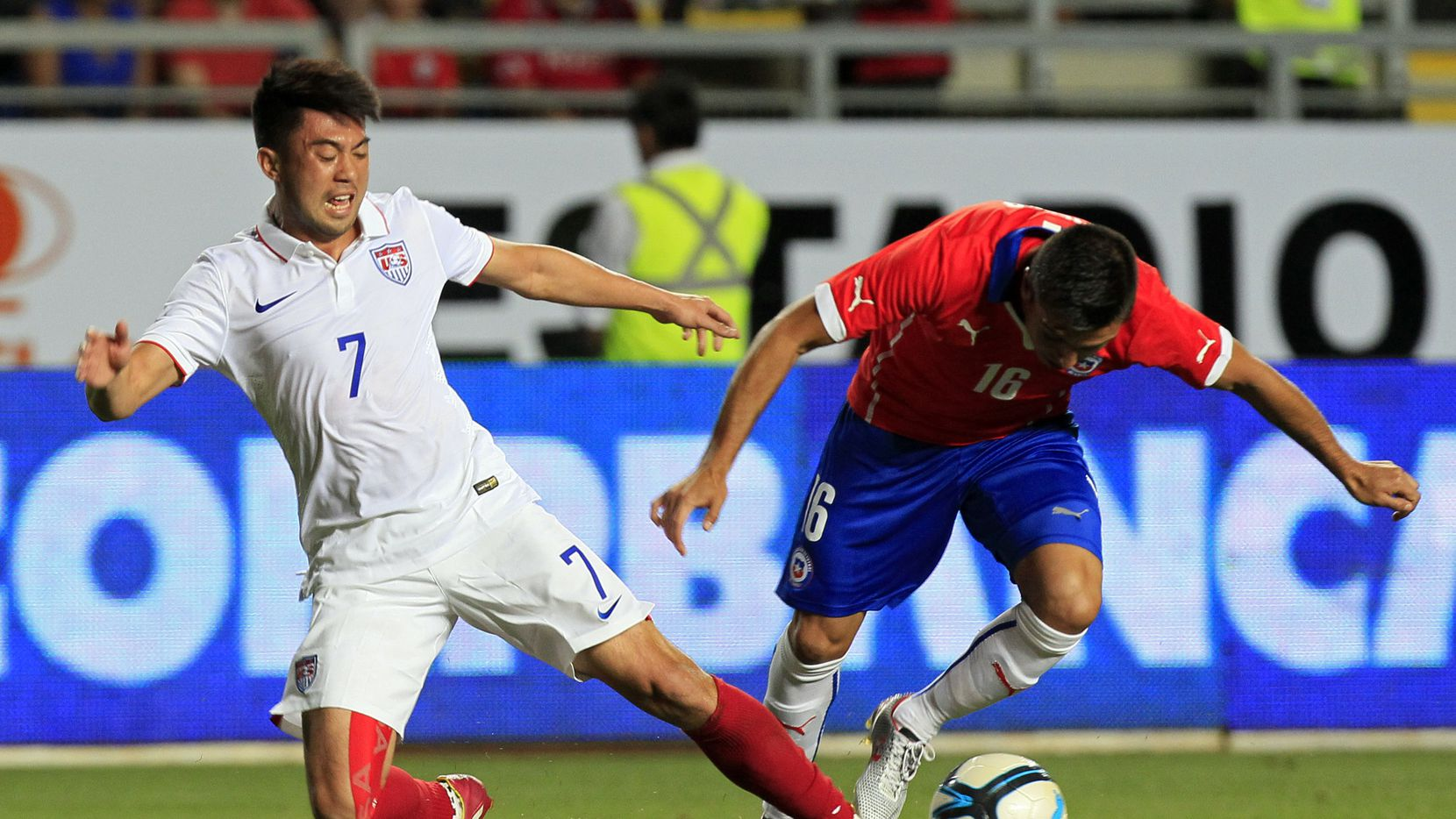 Lee Nguyen (left) fights for the ball with Chile's Gonzalo Fierro during a friendly in Rancagua, Chile.