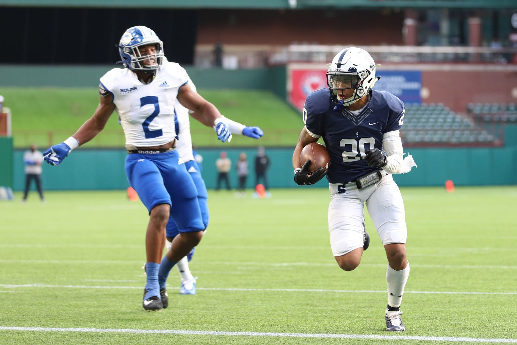 Fort Worth All Saints running back Nichlas Cole (20) runs for a touchdown against Fort Worth Nolan outside linebacker Vincent Paige (2) during the first half at Globe Life Park in Arlington, Saturday, December 5, 2020. (Elias Valverde II / Special Contributor)