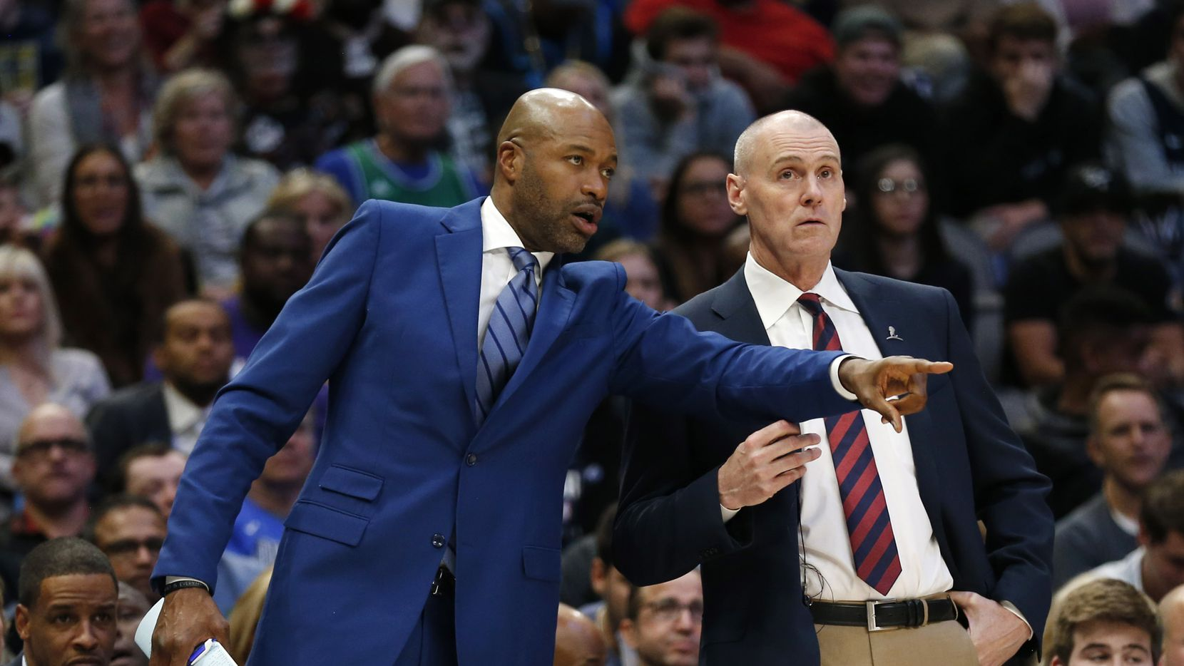 Dallas Mavericks assistant coach Jamahl Mosley talks with head coach Rick Carlisle during the second quarter of play against the Los Angeles Lakers at American Airlines Center in Dallas on Friday, November 1, 2019.