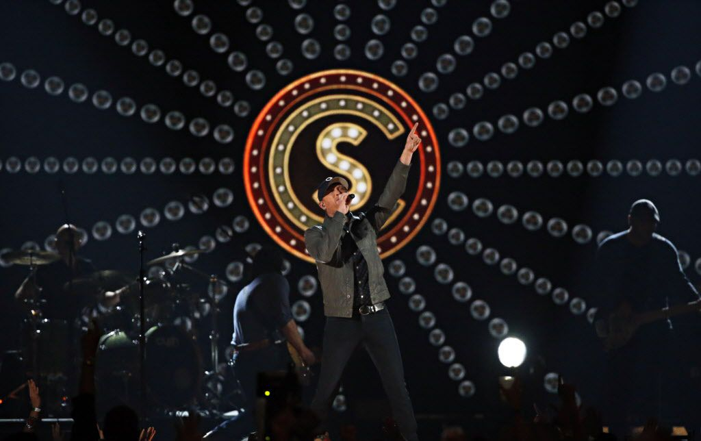 Cole Swindell performs during the 2015 Academy of Country Music Awards Sunday, April 19, 2015 at AT&T Stadium in Arlington, Texas.