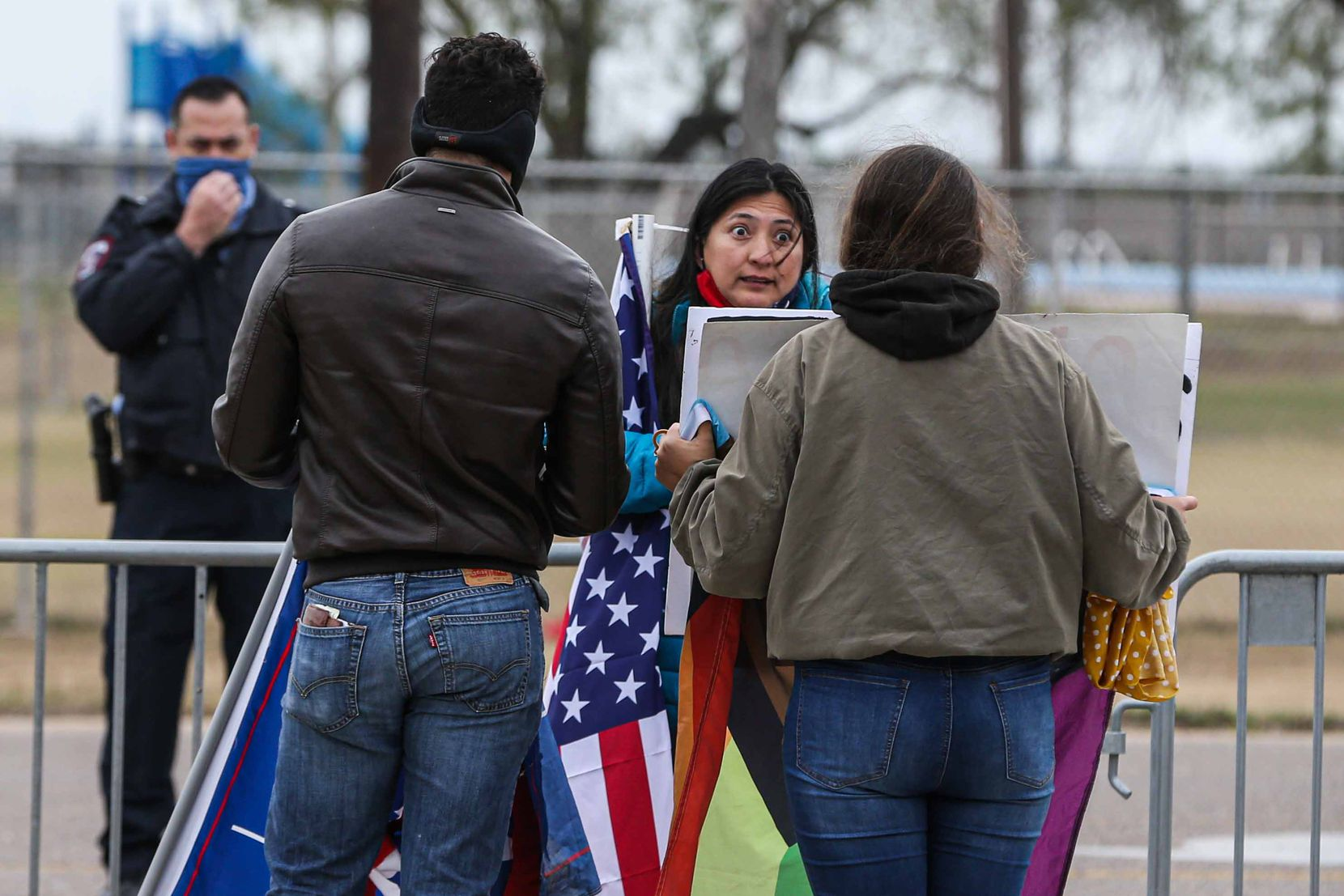 President Donald Trump supporters and president-elect Joe Biden supporters confront each other verbally during a rally as Trump is scheduled to visit part of the wall built under his mandate in McAllen on Tuesday, January 12, 2021.