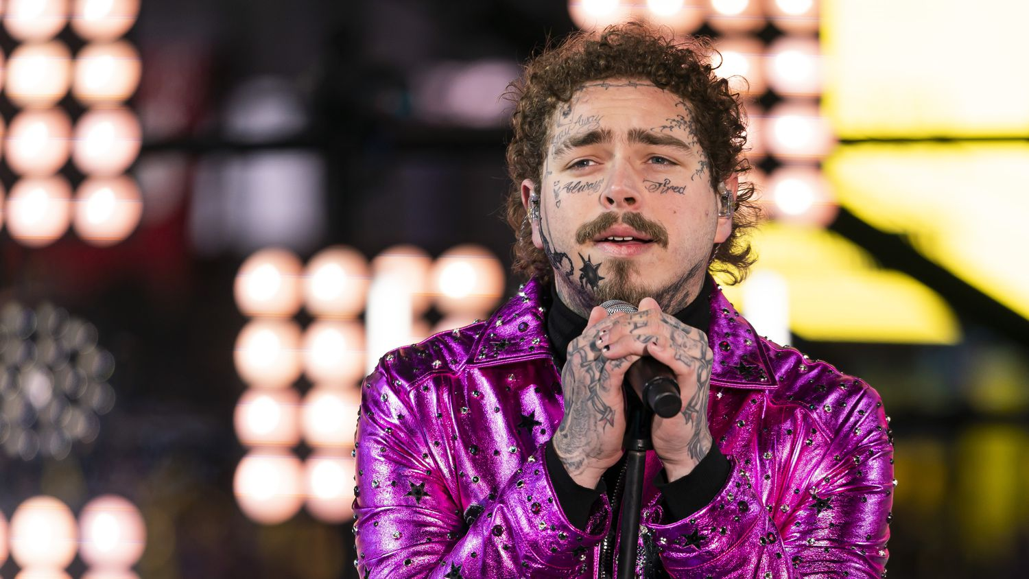 Grapevine native, and former employee at Chicken Express in Southlake, Post Malone performs at the 2020 New Year's Eve Times Square celebration.
