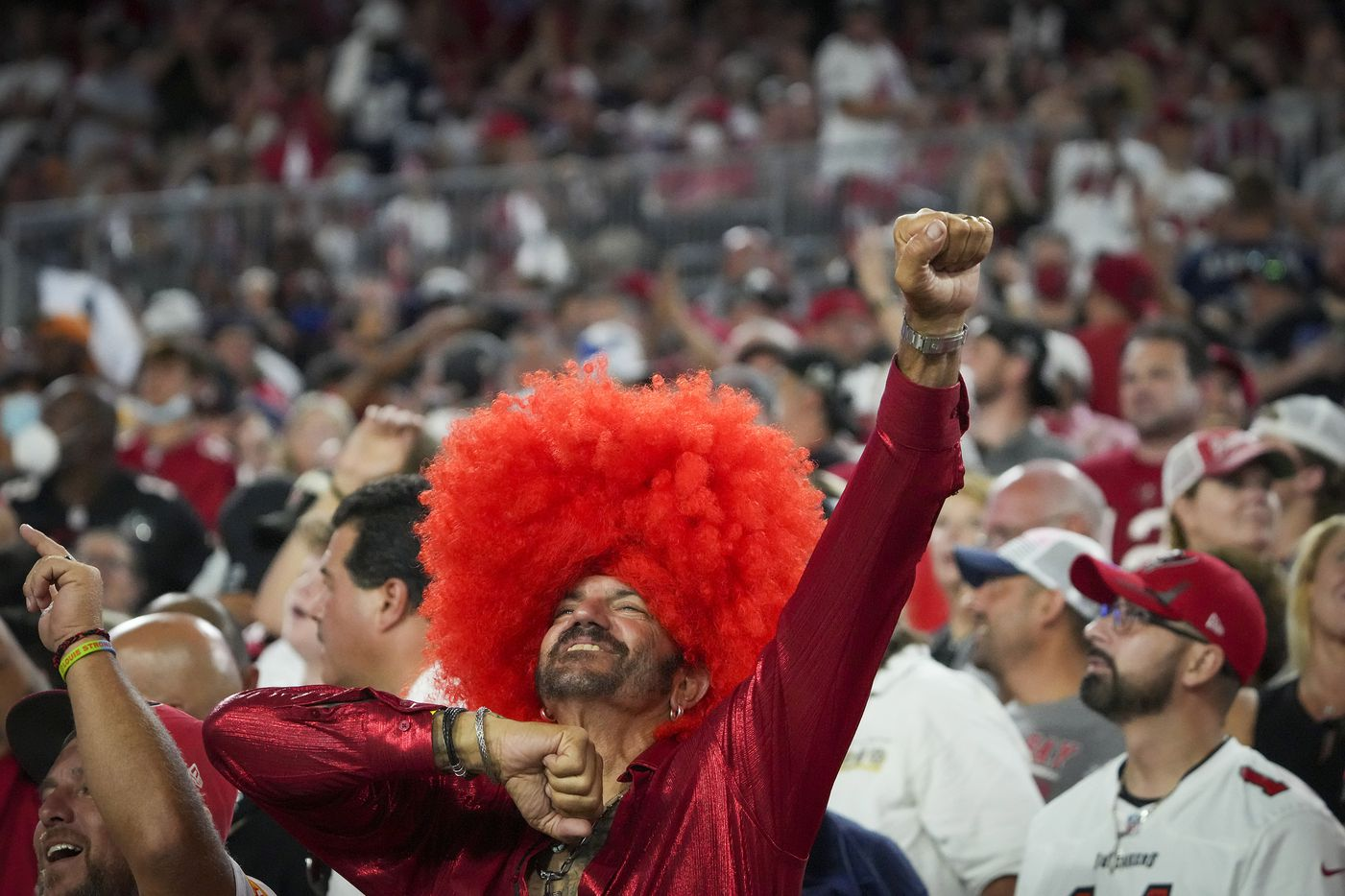 Tampa Bay Buccaneers fans celebrate after Dallas Cowboys place kicker Greg Zuerlein missed a point after attempt during the first half of an NFL football game at Raymond James Stadium on Thursday, Sept. 9, 2021, in Tampa, Fla. (Smiley N. Pool/The Dallas Morning News)