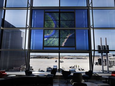 A translucent video image is displayed on the windows of the new Terminal D Extension at Dallas-Fort Worth International Airport.