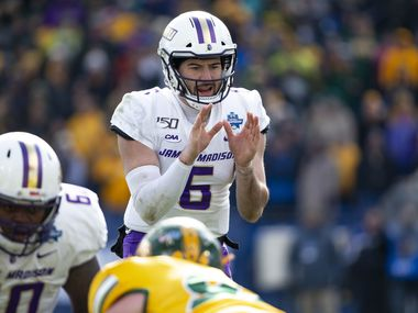 James Madison quarterback Ben DiNucci (6) waits for the ball to be snapped during the second half of the FCS championship NCAA college football game against North Dakota State, Saturday, Jan. 11, 2020, in Frisco, Texas.