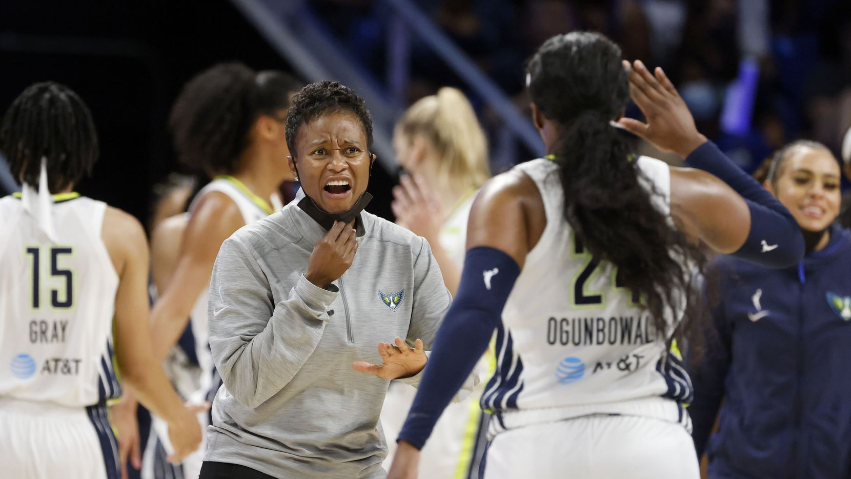 FILE — Dallas Wings head coach Vickie Johnson celebrates with guard Arike Ogunbowale (24) as they played the Los Angeles Sparks during the second half of a WNBA basketball game in Arlington, Texas on Sunday, Sept. 19, 2021.