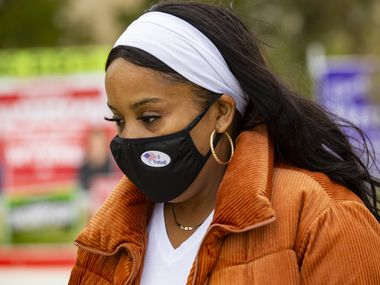 "Wanda Brooks wears an ""I voted"" sticker on her mask after voting at the Collin College campus in Wylie on Thursday, Oct. 29, 2020. (Juan Figueroa/ The Dallas Morning News)"