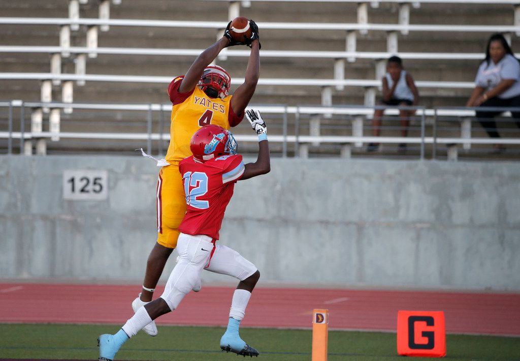 Houston Yates receiver Roy Lee Williams (4) catches a touchdown pass in front of Dallas Carter's Kyree Corbin (12) during the first half of their high school football game in Dallas, Texas on August 31, 2019. (Michael Ainsworth/Special Contributor)
