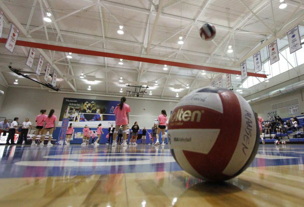 Parish Episcopal players warm-up prior to the start of their first game against Bishop Lynch. The two TAPPS 1-6A volleyball teams competed in their match at Parish Episcopal School in Dallas on October 3, 2017.(Steve Hamm/Special Contributor)