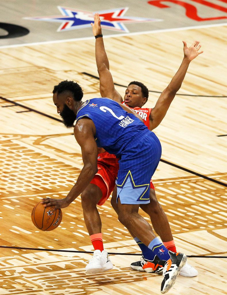 Team LeBron's James Harden (2) charges Team Giannis' Kyle Lowry (24) during the second half of play in the NBA All-Star 2020 game at United Center in Chicago on Sunday, February 16, 2020. Team LeBron defeated Team Giannis 157-155. (Vernon Bryant/The Dallas Morning News)