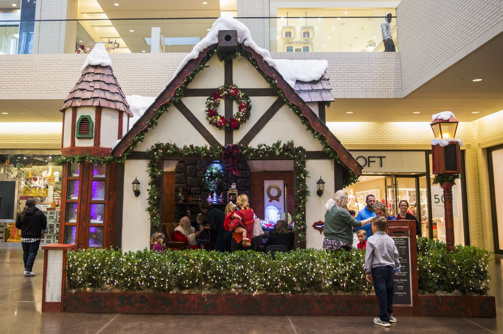 Santa Claus greets children in his house at NorthPark Center.