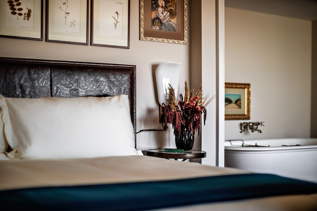 The NoMad Las Vegas hotel occupies the top four floors of the new Park MGM resort. The rooms are done up with wood floors, area rugs and stylish art.