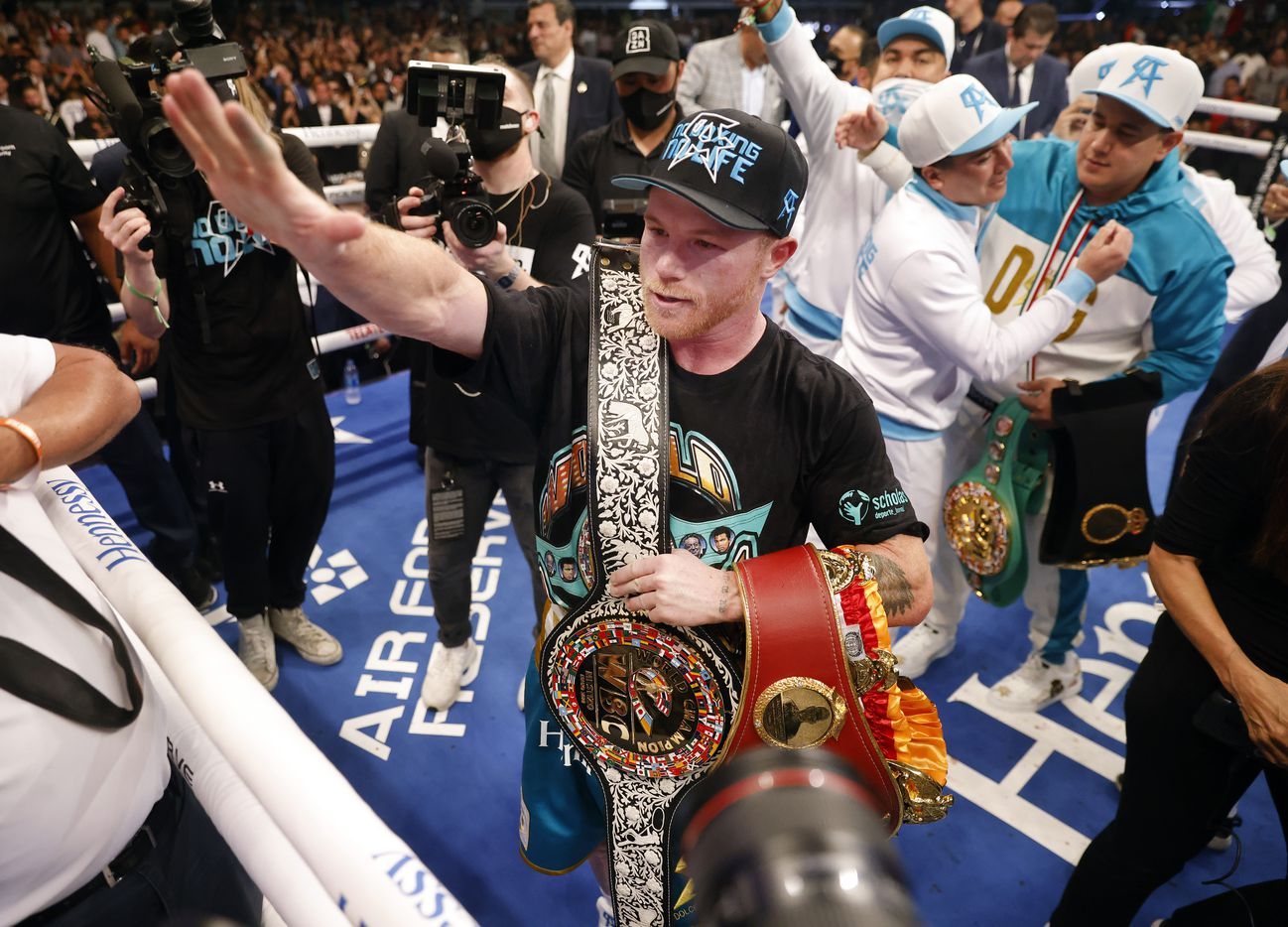 Boxers Canelo Alvarez celebrates with his belts after defeating Billy Joe Saunders in the eighth round of their super middleweight title fight at AT&T Stadium in Arlington, Saturday, May 8, 2021.  Sauders couldn't go on because he unsustained an eye injury and couldn't see. (Tom Fox/The Dallas Morning News)