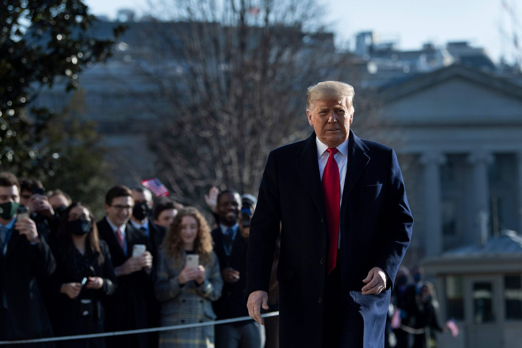 President Donald Trump walked by supporters outside the White House on Jan. 12. (Brendan Smialowski/AFP)