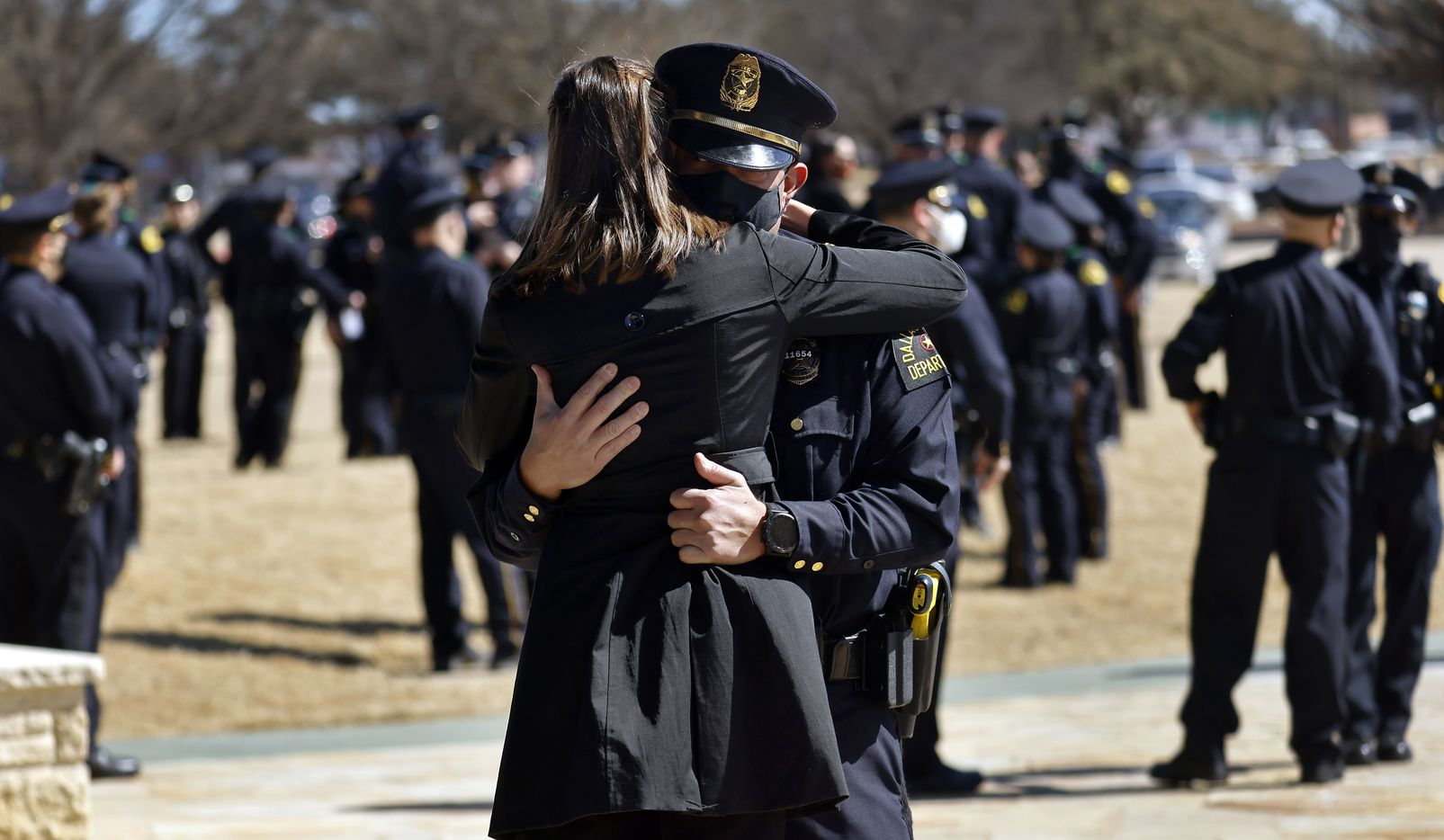Dallas Police Lt. Dr. Alex Eastman comforts a family member following the funeral service for Dallas Police officer Mitchell Penton at Prestonwood Baptist Church in Plano, Monday, February 22, 2021. Penton was killed Saturday, Feb. 13, 2021, in a crash involving a drunk driving suspect. (Tom Fox/The Dallas Morning News)