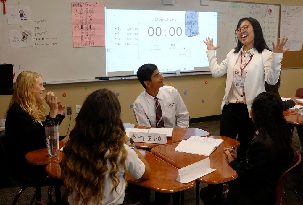 From left: Austin Crawford, 15, Emma Bedford, 14, Ashwin Karthikeyan, 15, and Dulce Ramirez, 14, listen as Qiongyu Hu leads discussion in her Chinese class at International Leadership of Texas Keller-Saginaw High School.