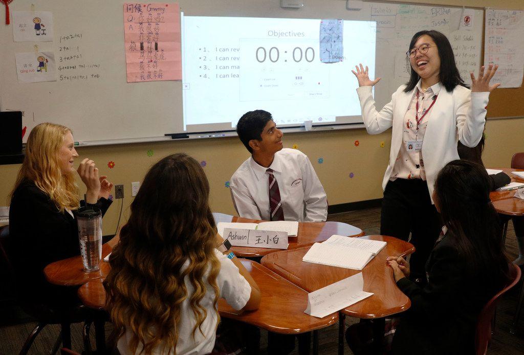 From left: Austin Crawford, 15, Emma Bedford, 14, Ashwin Karthikeyan, 15, and Dulce Ramirez, 14, listen as Qiongyu Hu leads discussion in her Chinese class at International Leadership of Texas Keller-Saginaw High School.