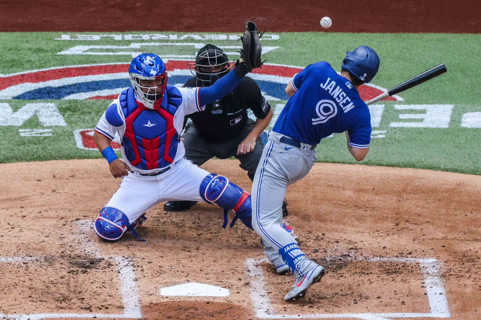Toronto Blue Jays' Danny Jansen No. 9 dodges a ball in home plate at the Globe Life Field during opening day against Texas Rangers in Arlington, Texas on Monday, April 5, 2021. (Lola Gomez/The Dallas Morning News)