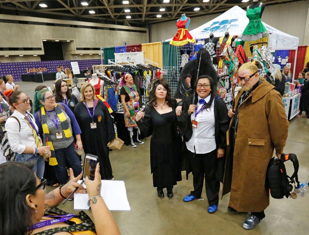 Costumed fans pose for photos for other Harry Potter devotees at LeakyCon.